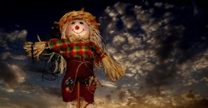 Scarecrow against sunset